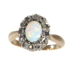 Victorian rose cut diamond ring set with nice cabochon opal by Unknown