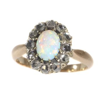 Victorian rose cut diamond ring set with nice cabochon opal by Unknown Artist