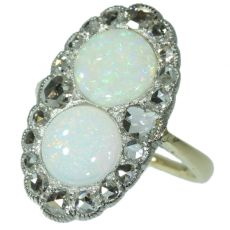 Antique Victorian engagement ring with rose cut diamonds and cabochon opals by Unknown