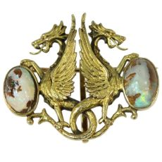 Charming Victorian brooch depicting two griffons protecting their egg by Unknown