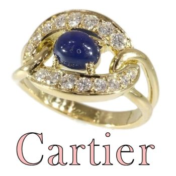 Vintage luxury CARTIER ring with sapphire and diamonds by Cartier .
